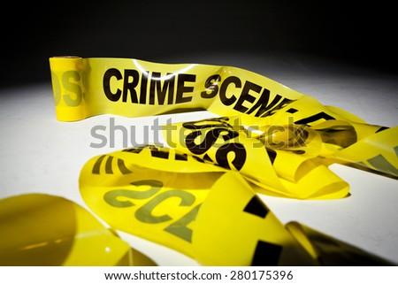 Yellow crime scene 'Do not cross' tape - stock photo