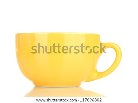 Yellow cup and saucer isolated on white - stock photo