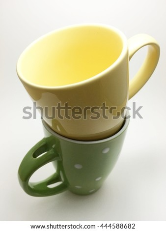 yellow cup is top - stock photo