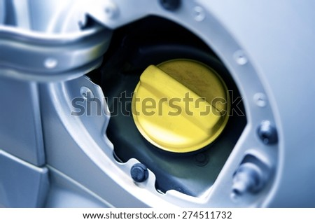 Yellow Cup of Car Fuel Inlet. Gas and Fueling Photo Concept. - stock photo