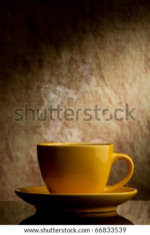 yellow cup of coffee  on a old stone background. - stock photo