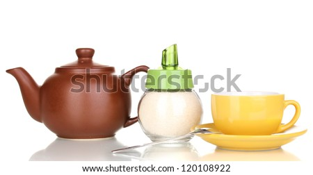 Yellow cup with saucer and teapot isolated on white - stock photo