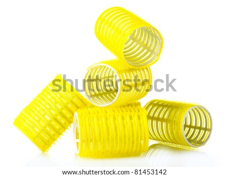 yellow curlers isolated on white