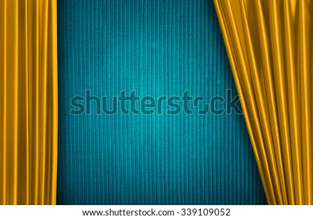 Yellow curtain on theater or cinema stage slightly open - stock photo