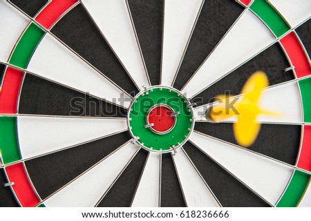 Yellow dart board out of target middle frame