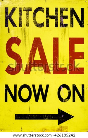 Yellow dayglo kitchen sale sign.