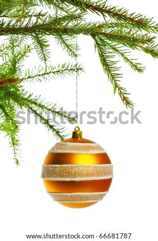 yellow decoration ball on fir branch - stock photo