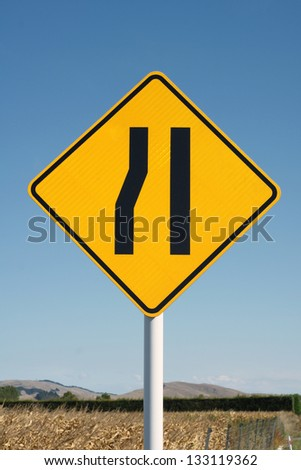 Yellow diamond shape yield sign - stock photo