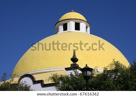 Yellow Dome on Mexican Building - stock photo