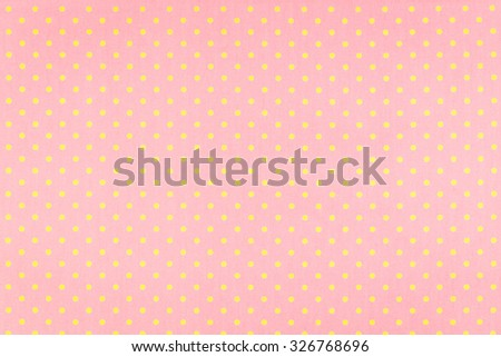 yellow dot over pink Polka dot fabric background and texture - stock photo