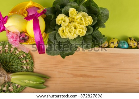 yellow Easter eggs with flowers