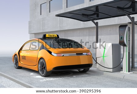 Yellow electric taxi charging in charging station. The charging station supply by solar panel and battery. - stock photo