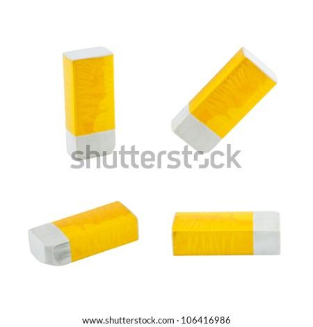 Yellow eraser set isolated on white - stock photo