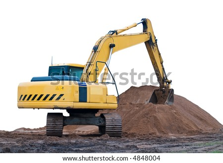 yellow excavator at the sand heap - stock photo