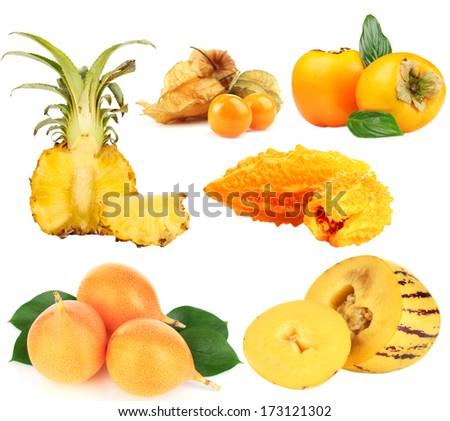 Yellow exotic fruits isolated on white - stock photo