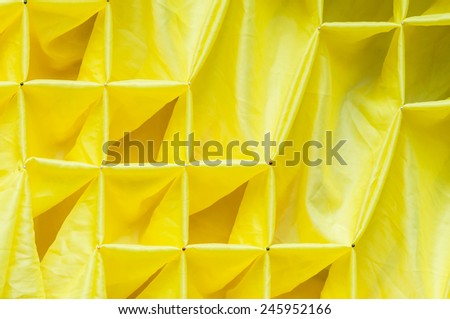 Yellow fabric on the table of Thai festival. - stock photo