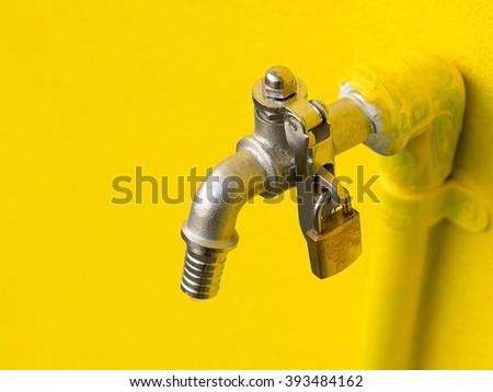 Yellow Faucet On Yellow Wall Padlock Stock Photo 393484162 ...