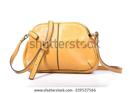 Yellow female leather bag, With bow black on an isolated white background