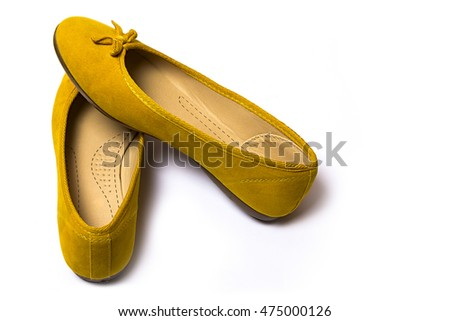 yellow female shoes closeup view from above on white background