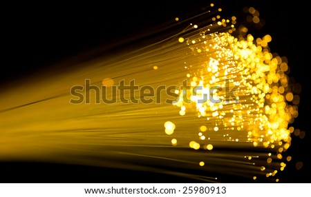 yellow fiber optics cable close up shot - stock photo