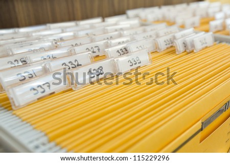 Yellow file cabinet on  a hotel reception - stock photo