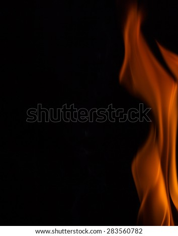 Yellow fire flames, isolated on black background - stock photo