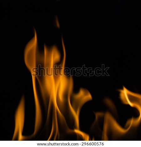 Yellow fire flames, isolated on black background, - stock photo