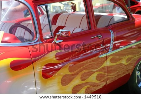 Yellow Flames on Red Vintage Car - stock photo