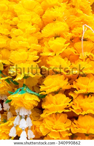 Yellow flower garlands - offerings in buddhist temple - stock photo
