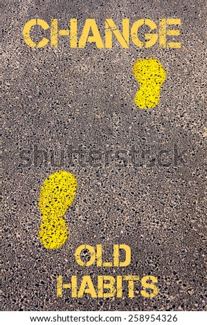 Yellow footsteps on sidewalk from Old Habits to Change message. Concept image - stock photo
