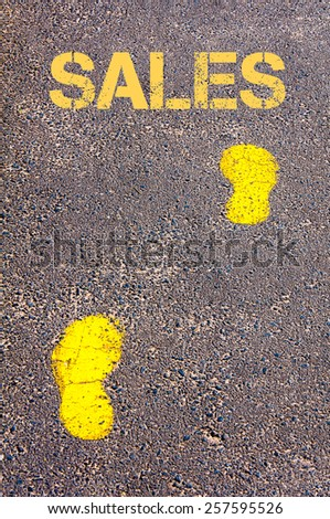 Yellow footsteps on sidewalk towards Sales message.Conceptual image