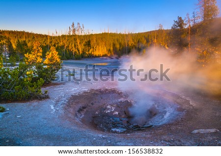 Yellow funnel Spring at Sunset - Norris Basin Yellowstone - stock photo