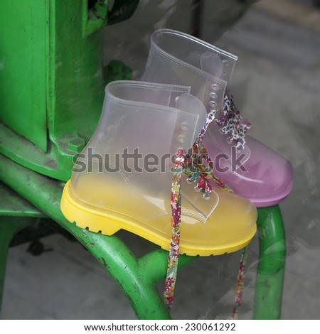 yellow funny boots on vintage market - stock photo