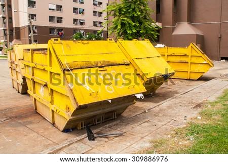 Yellow Garbage Bin - stock photo