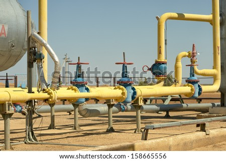 Yellow gas pipe on a group setting. - stock photo