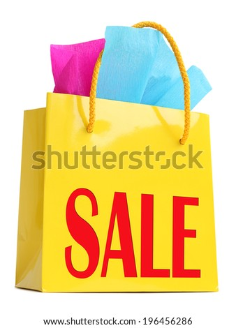 """Yellow gift bag stuffed with pink and turquoise tissue paper and red """"SALE"""" superscription, isolated on white - stock photo"""
