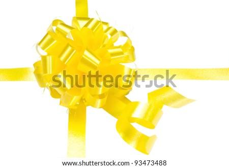Yellow gift bow on white background - stock photo