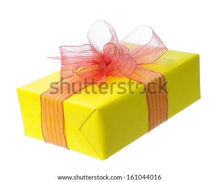 Yellow gift box isolated on white - stock photo