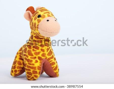 yellow giraffe over white background. Animal toy - stock photo