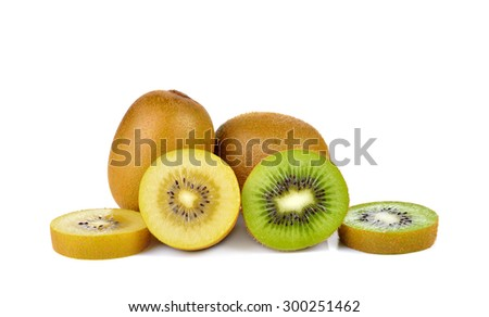 Yellow gold and green kiwi  on white background - stock photo
