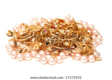 Yellow gold and pink pearl jewelry - stock photo