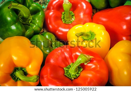 Yellow, green and red colorful bell peppers, natural background - stock photo