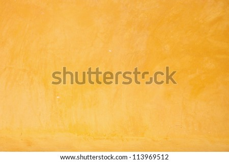 Yellow grunge cement wall, textured background - stock photo