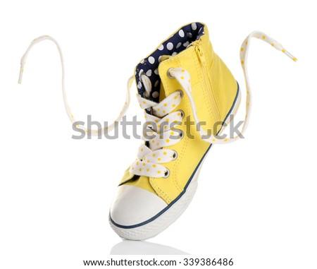 Yellow gumshoe isolated on white - stock photo