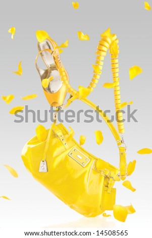 Yellow handbag and pumps. Bright yellow handbag, high heel pumps and confetti.