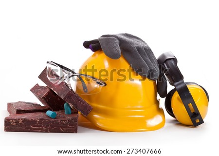 Yellow hard hat, earphones, goggles, gloves and facing stone on a white background - stock photo