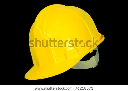 Yellow hard hat isolated on black