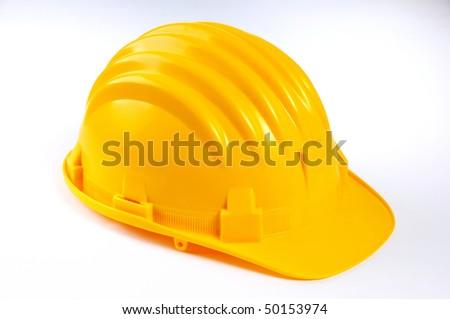 YELLOW HARD HAT ON WHITE - stock photo