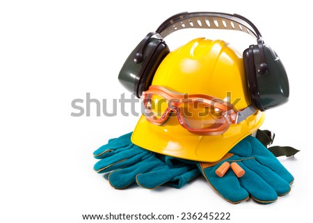 Yellow hard hat, safety goggles, earphones and gloves on a white background - stock photo