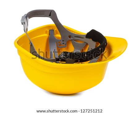yellow hard hat upside down, small natural shadowo under object - stock photo